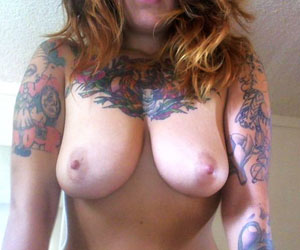 Bigboobs emo tayte shows her huge tats. Tayte. We got a hot emo flirty babe for you here! Tayte flashes out her amazing pair of tits. Her huge tattoos are really shocking and sexy. Shes one hot emo slut.